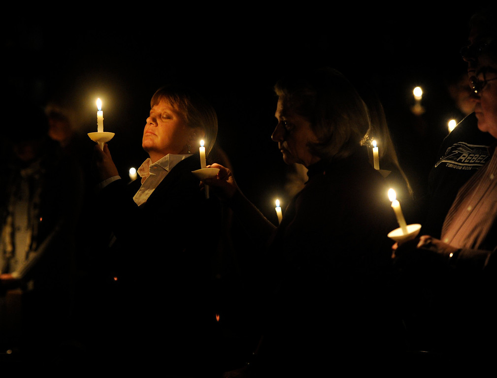 Description of . The University Park United Methodist Church hosts a candlelight vigil on Sat., Dec. 15, 2012 to gather and pray and to memorialize those involved in the Connecticut school shooting. Kathryn Scott Osler, The Denver Post