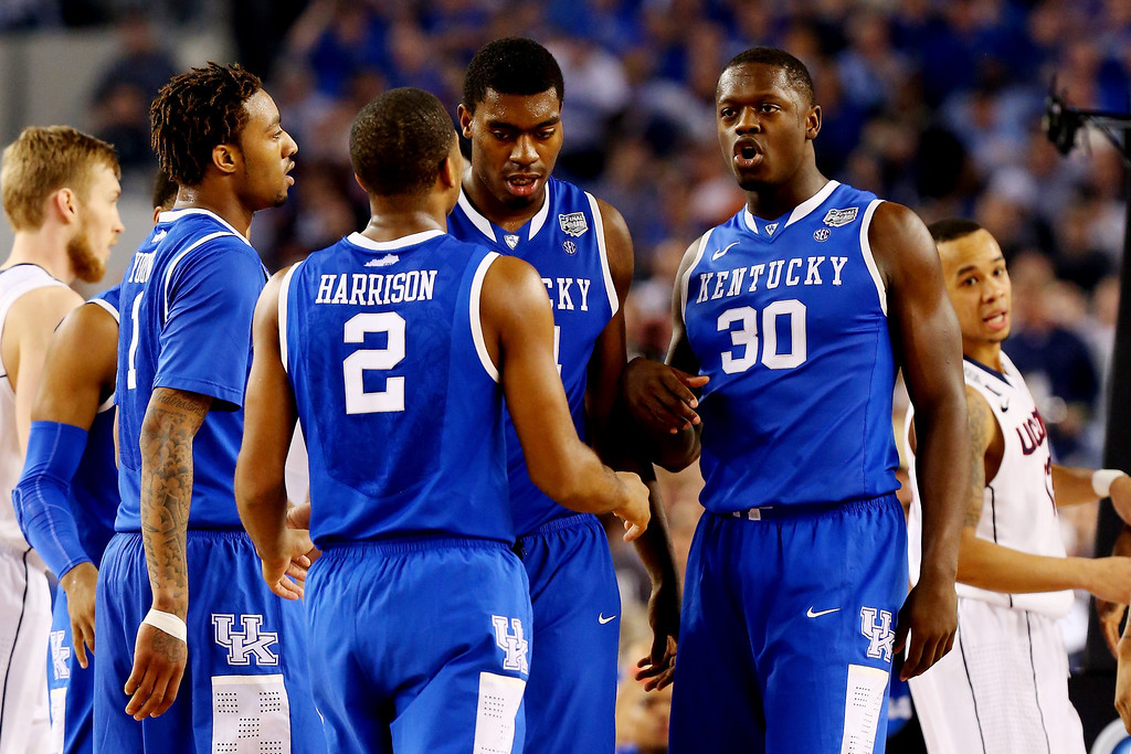 Description of . ARLINGTON, TX - APRIL 07: The Kentucky Wildcats huddle during the NCAA Men\'s Final Four Championship against the Connecticut Huskies at AT&T Stadium on April 7, 2014 in Arlington, Texas.  (Photo by Ronald Martinez/Getty Images)