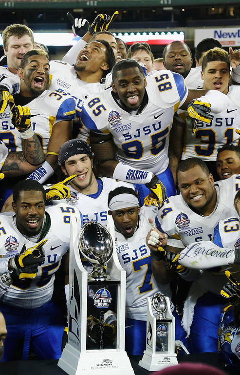 Description of . Members of the San Jose State Spartans pose with the trophy after defeating the Bowling Green Falcons 29-20 to win the Military Bowl at RFK Stadium on December 27, 2012 in Washington, DC.  (Photo by Rob Carr/Getty Images)