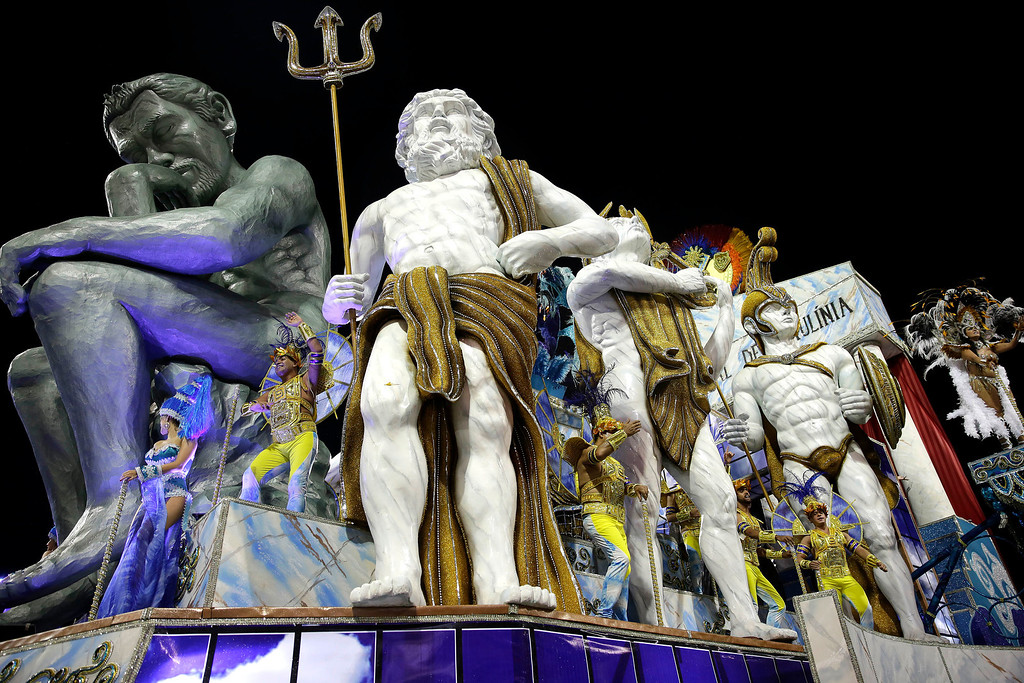 Description of . Dancers from the Vai-Vai samba school perform on a float during a carnival parade in Sao Paulo, Brazil, Saturday, March 1, 2014. (AP Photo/Andre Penner)
