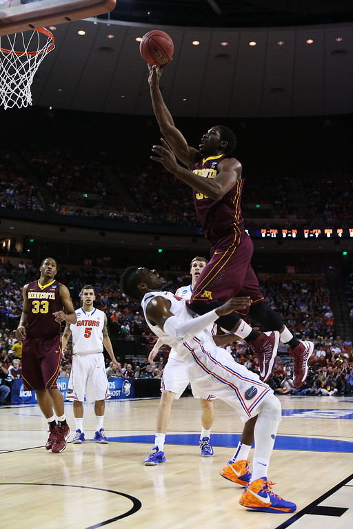 . Trevor Mbakwe #32 of the Minnesota Golden Gophers goes up against Will Yeguete #15 of the Florida Gators in the first half during the third round of the 2013 NCAA Men\'s Basketball Tournament at The Frank Erwin Center on March 24, 2013 in Austin, Texas.  (Photo by Stephen Dunn/Getty Images)