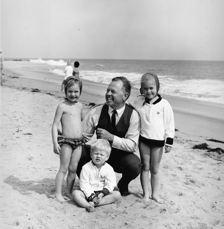 Description of . Actor Mickey Rooney is pictured with his children at a beach location in this undated photograph. From left are: daughter Kerry, 4, son Kyle, 3, and 5-year-old daughter Kelly, 5.  (AP Photo)