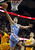 Denver Nuggets Danilo Gallinari (8) lays the ball in between Cleveland Cavaliers defenders Tristan Thompson (13) and Tyler Zeller during the first quarter of their NBA basketball game in Cleveland, February 9, 2013.  REUTERS/Aaron Josefczyk