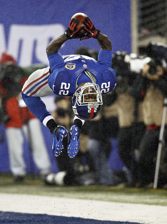Description of . David Wilson #22 of the New York Giants celebrates his third touchdown of a game against the New Orleans Saints at MetLife Stadium on December 9, 2012 in East Rutherford, New Jersey.  (Photo by Jeff Zelevansky/Getty Images)