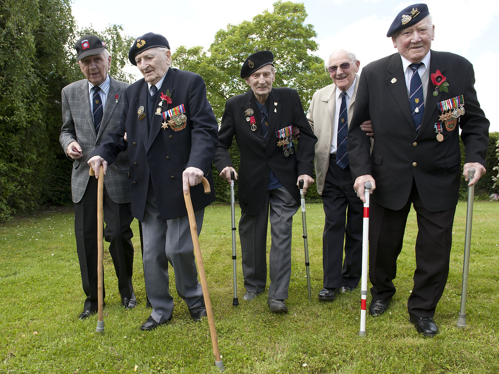 Description of . CAEN, FRANCE - JUNE 06:   Members of the 16th Walsall branch of the Normandy veteran's asscoiation arrive in (LtoR) sgt Ken Reynolds (90), Able Seaman Ronald Davies (88), Signalman Gordon Poole (89), Sub lt rnbr Geoff Ensor (90) and  Corporal Frank Corbett (93) arrive for D-Day 70 Commemorations on June 6, 2014 in Caen, France. Friday 6th June is the 70th anniversary of the D-Day landings which saw 156,000 troops from the allied countries including the United Kingdom and the United States join forces to launch an audacious attack on the beaches of Normandy,  these assaults are credited with the eventual defeat of Nazi Germany. A series of events commemorating the 70th anniversary are planned for the week with many heads of state travelling to the famous beaches to pay their respects to those who lost their lives. (Photo by Murray Sanders - Pool/Getty Images)
