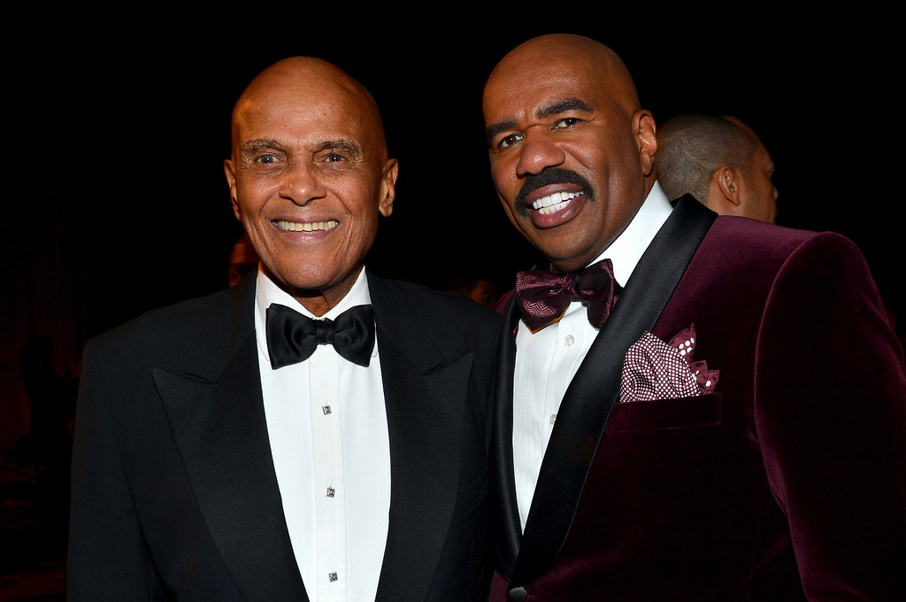 Description of . LOS ANGELES, CA - FEBRUARY 01:  Honoree Harry Belafonte (L) and host Steve Harvey attend the 44th NAACP Image Awards at The Shrine Auditorium on February 1, 2013 in Los Angeles, California.  (Photo by Alberto E. Rodriguez/Getty Images for NAACP Image Awards)