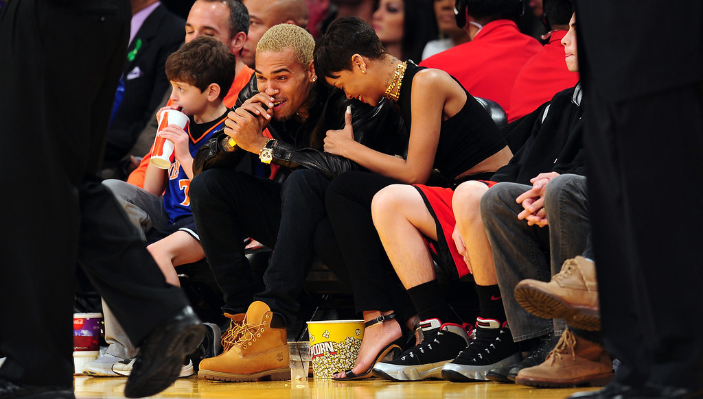 Description of . Rihanna (R) and Chris Brown (L) attend an NBA game between the New York Knicks and the Los Angeles Lakers at Staples Center in Los Angeles, California, on Christmas Day, December 25, 2012.  ROBYN BECK/AFP/Getty Images