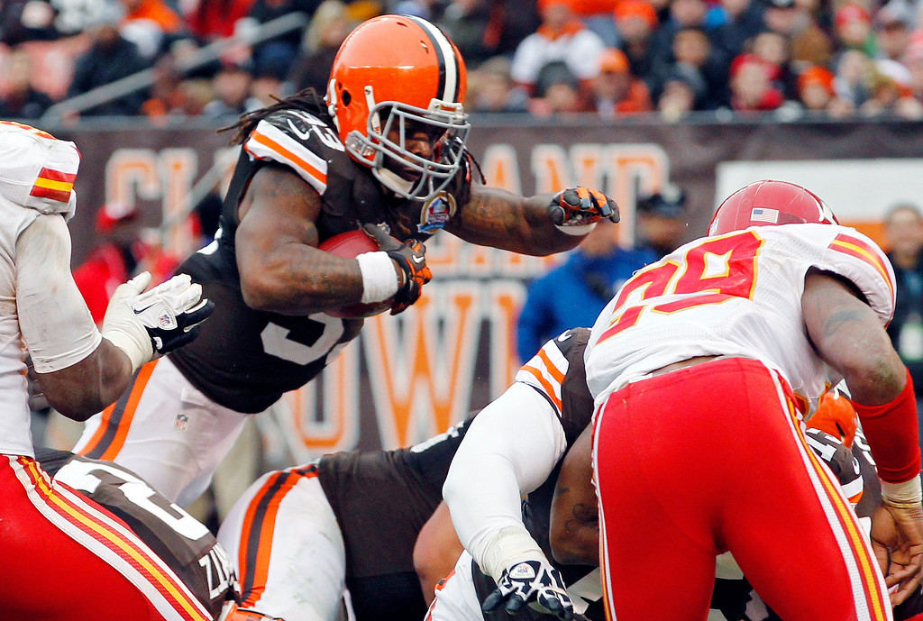 Description of . Cleveland Browns running back Trent Richardson dives over the goal line on a 1-yard touchdown run in the third quarter of an NFL football game against the Kansas City Chiefs, Sunday, Dec. 9, 2012, in Cleveland. (AP Photo/Tony Dejak)