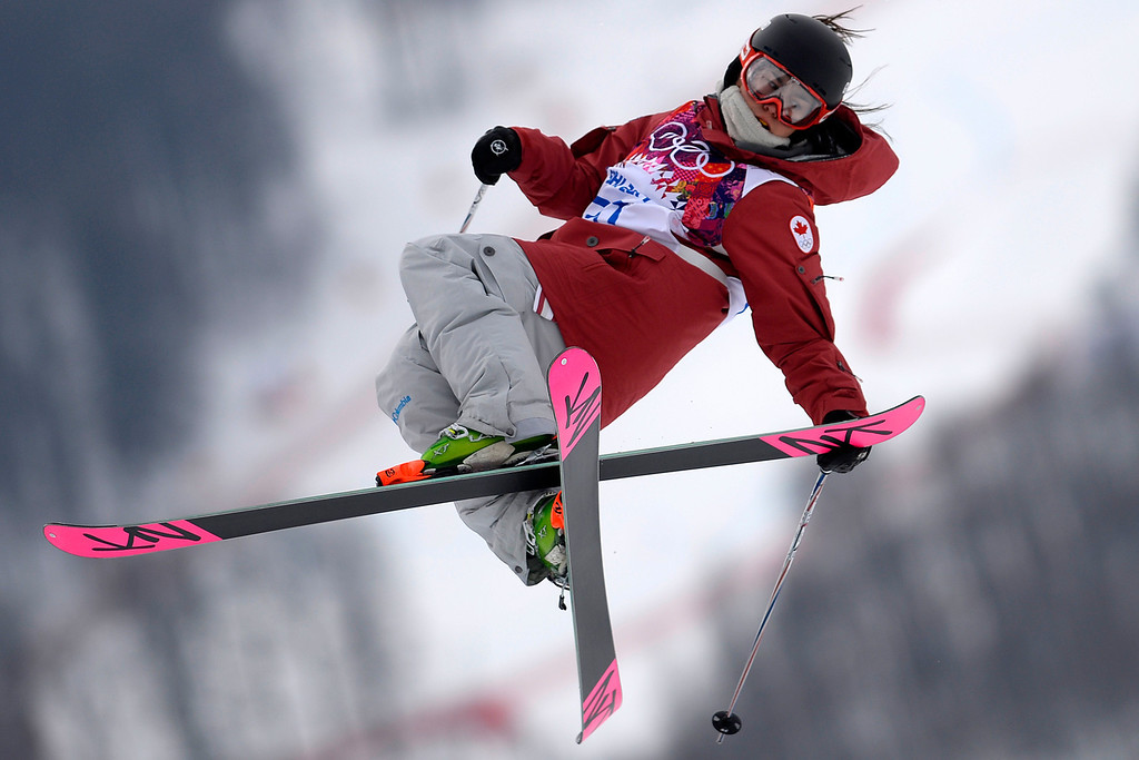 Description of . Britain\'s Katie Summerhayes pokes her tongue out after a run in the women\'s freestyle skiing slopestyle qualifying at the Rosa Khutor Extreme Park at the 2014 Winter Olympics, Tuesday, Feb. 11, 2014, in Krasnaya Polyana, Russia. (AP Photo/Andy Wong)