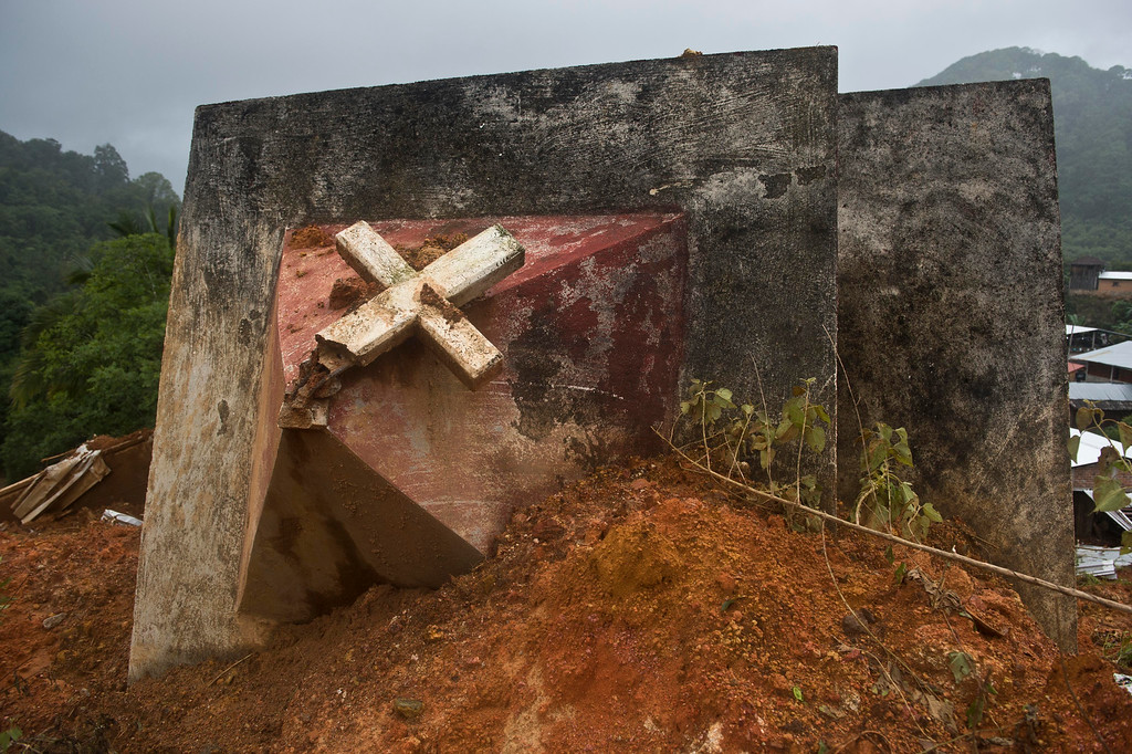 Description of . The remains of a the tower of the church can be seen after a landslide in La Pintada, state of Guerrero, Mexico, on September 19, 2013 as heavy rains hit the country.   AFP PHOTO/RONALDO Schemidt/AFP/Getty Images
