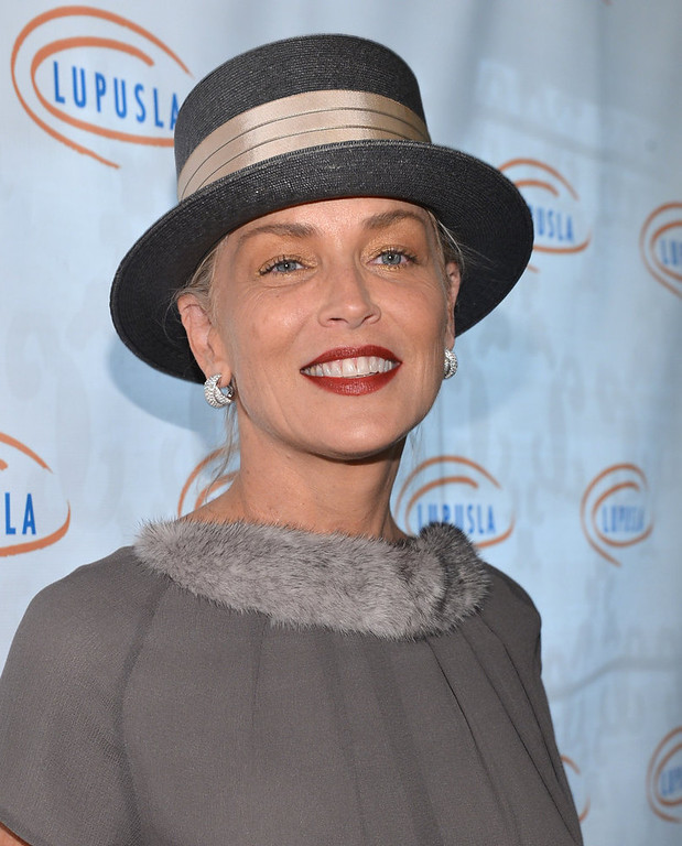 Description of . Actress Sharon Stone arrives to the Lupus LA 10th Anniversary Hollywood Bag Ladies Luncheon at Regent Beverly Wilshire Hotel on November 1, 2012 in Beverly Hills, California.  (Photo by Alberto E. Rodriguez/Getty Images For Lupus LA)
