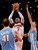 New York Knicks forward Carmelo Anthony drives to the basket defended by Denver Nuggets forward Danilo Gallinari and center Kosta Koufos (L) in the fourth quarter of their NBA basketball game at Madison Square Garden in New York, December 9, 2012.    REUTERS/Adam Hunger