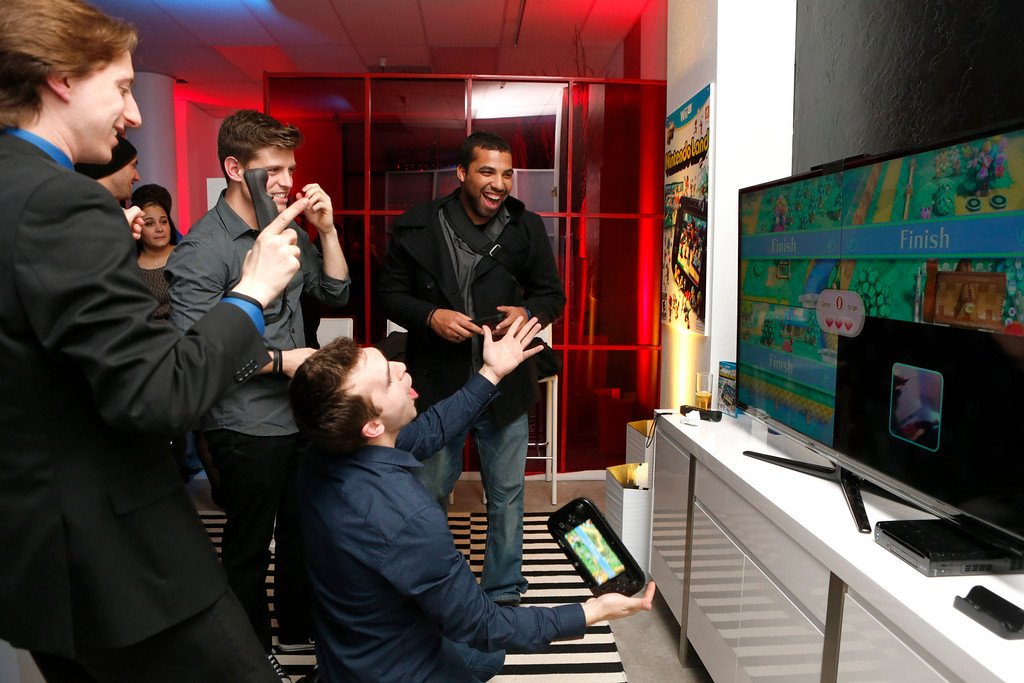 Description of . Jared Knabenbauer, (from Pro Jared,) TJ Smith (from Ivy League Punk,) Shawn Caple (from Underbelly) and guest seen at the Nintendo Wii U Video Challenge at the Nintendo Lounge at Sundance 2013, on Thursday, January, 17, 2013 in Park City, Utah. (Photo by Todd Williamson/Invision for Nintendo/AP Images)