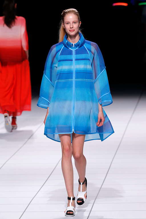 Description of . A model presents a creation as part of Issey Miyake's ready-to-wear Spring/Summer 2014 fashion collection, presented Friday, Sept. 27, 2013 in Paris. (AP Photo/Jacques Brinon)