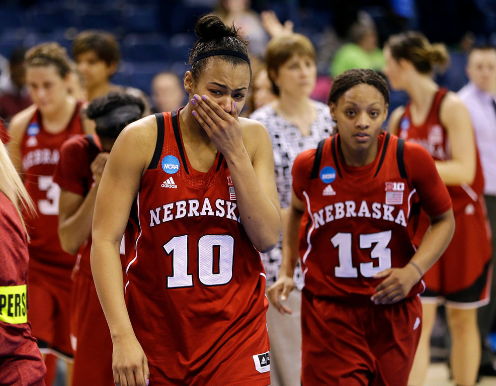Description of . Nebraska forward Meghin Williams (10) becomes emotional as she and guard Brandi Jeffery (13) leave the court after their 53-45 loss to Duke in a regional semifinal in the women\'s NCAA college basketball tournament, Sunday, March 31, 2013, in Norfolk, Va. (AP Photo/Steve Helber)
