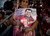A woman holds a candle along with a poster of Venezuela's President Hugo Chavez at a candlelight vigil to pray for his health in Caracas, Venezuela in this Feb. 22, 2013 file photo. Venezuela's Vice President Nicolas Maduro announced the death of President Hugo Chavez in Caracas on March 5, 2013. (AP Photo/Ariana Cubillos)