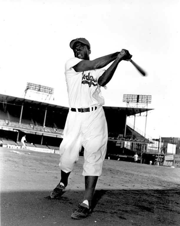 Description of . Jackie Robinson, infielder for the Brooklyn Dodgers, swings his bat in this action pose at Ebbett\'s Field in Brooklyn, N.Y., on May 9, 1951.  (AP Photo)