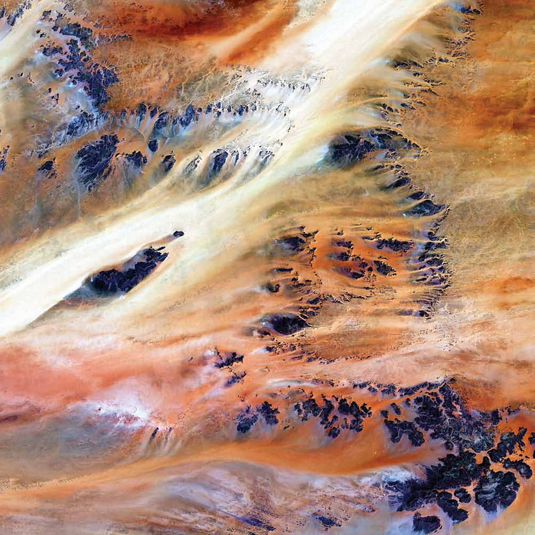 Description of . Terkezi Oasis, Chad A series of rocky outcroppings emerge from a blanket of sand in this 2000 Landsat 7 image of the Sahara Desert near the Terkezi Oasis in the country of Chad. As Earth�s largest band of dry land, the Sahara dominates the northern third of Africa. Stretching across this immense desert are vast plains of sand and gravel; seas of sand dunes; and barren, rocky mountains. Only 10,000 years ago, grasses covered the region and mammals such as lions and elephants roamed the land. Now only 2 percent of the Sahara hosts oases, patches of land usually centered on natural water springs where crops will grow and people live.   NASA