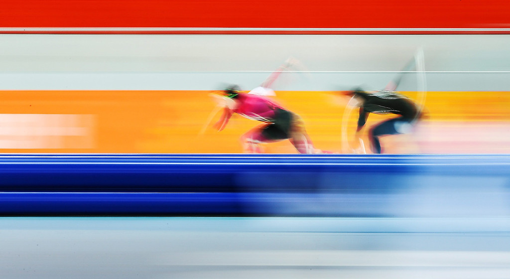 Description of . Jenny Wolf of Germany (L) and Heather Richardson of the USA in action during the women\'s 500 m Race 1 of the Speed Skating event in the Adler Arena at the Sochi 2014 Olympic Games, Sochi, Russia, on Feb. 11, 2014.  EPA/HANNIBAL HANSCHKE