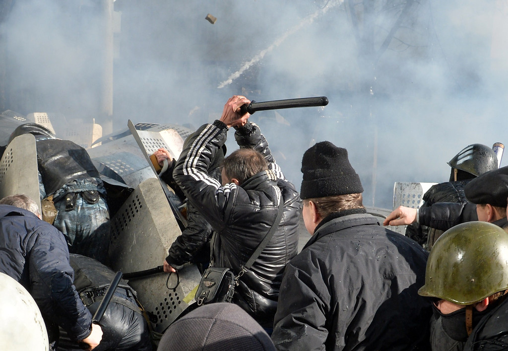 Description of . Anti-government protesters clash with police in the center of  Kiev on February 18, 2014. Police on Tuesday fired rubber bullets at stone-throwing protesters as they demonstrated close to Ukraine's parliament in Kiev, an AFP reporter at the scene said. Police also responded with smoke bombs after protesters hurled paving stones at them as they sought to get closer to the heavily-fortified parliament building. AFP PHOTO/ SERGEI  SUPINSKY/AFP/Getty Images