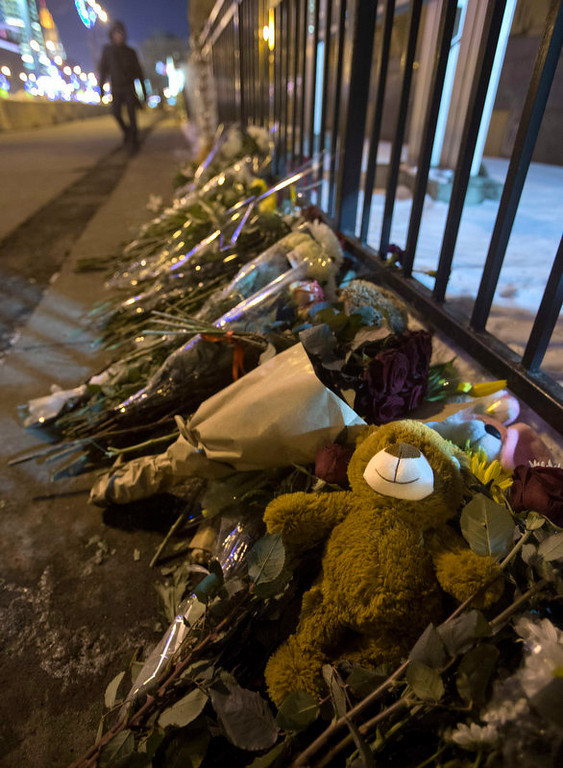 Description of . Flowers and toys lay near the U.S. Embassy in Moscow, Russia, Saturday, Dec. 15, 2012.  The massacre of 26 children and adults at Sandy Hook Elementary school elicited horror and soul-searching around the world even as it raised more basic questions about why the gunman, 20-year-old Adam Lanza, would have been driven to such a crime and how he chose his victims. (AP Photo / Misha Japaridze)