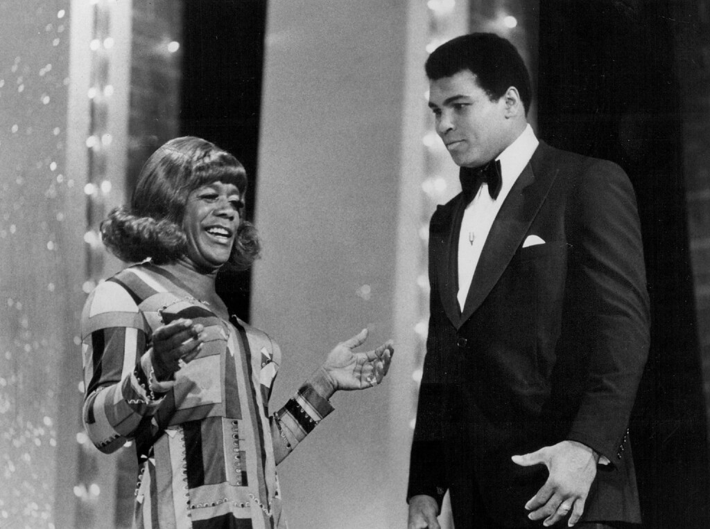 Description of . Flip Wilson with Muhammad Ali in 1975. Denver Post Library photo archive