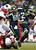 Seattle Seahawks running back Marshawn Lynch (24) runs for a 33-yard touchdown past Arizona Cardinals strong safety Rashad Johnson (49) and inside linebacker Daryl Washington (58) during the third quarterof an NFL football game in Seattle, Sunday, Dec. 9, 2012.  (AP Photo/John Froschauer)