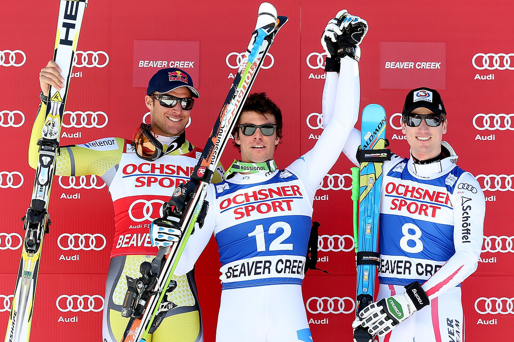 Description of . Aksel Lund Swindal #19 of Norway, Matteo Marsaglia #12 of Italy and Hannes Reichelt #8 of Austria celebrate on the winner\'s podium during the men\'s Super G on the Birds of Prey at the Audi FIS World Cup on December 1, 2012 in Beaver Creek, Colorado.  (Photo by Matthew Stockman/Getty Images)