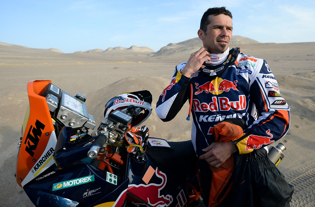 Description of . KTM rider Cyril Despres of France gets ready before the start of the 2nd stage of the 2013 Dakar Rally in Pisco, Peru,  Sunday, Jan. 6, 2013. The race finishes in Santiago, Chile, on Jan. 20. (AP Photo/Franck Fife, Pool)