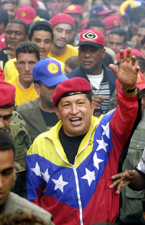 Description of . In this Jan. 23, 2002 file photo, Venezuela's President Hugo Chavez waves to supporters during a government march commemorating the anniversary of Venezuelan democracy in Caracas, Venezuela. Chavez died March 5, 2013 at age 58. (AP Photo/Fernando Llano, File)