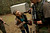 A member of the North Florida Survival Group shows the daughter of another member how to operate the magazine release of an SKS rifle during a field training exercise in Old Town, Florida, December 8, 2012.  The group trains children and adults alike to handle weapons and survive in the wild. The group passionately supports the right of U.S. citizens to bear arms and its website states that it aims to teach 