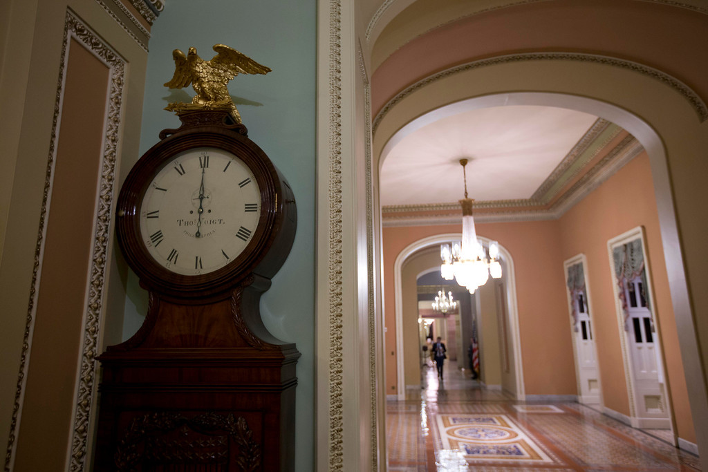 Description of . The Ohio Clock strikes midnight as the Senate continues to work on the fiscal cliff, on Capitol Hill Tuesday, Jan. 1, 2013 in Washington. (AP Photo/Alex Brandon)