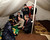 U.N. Secretary-General Ban Ki-moon (squatting C) chats with a Syrian refugee woman during his visit to a camp in the Turkish town of Islahiye, Gaziantep province December 7, 2012. Ban said on Friday he was not aware of any confirmed reports that Syrian President Bashar al-Assad was preparing to use chemical weapons but that if he did so it would be an