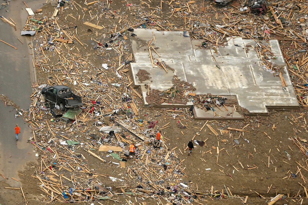 Description of . A concrete slab and rubble are all that is left of a home in Vilonia, Ark., neighborhood Monday, April 28, 2014, after a tornado struck the town late Sunday. (AP Photo/Danny Johnston)