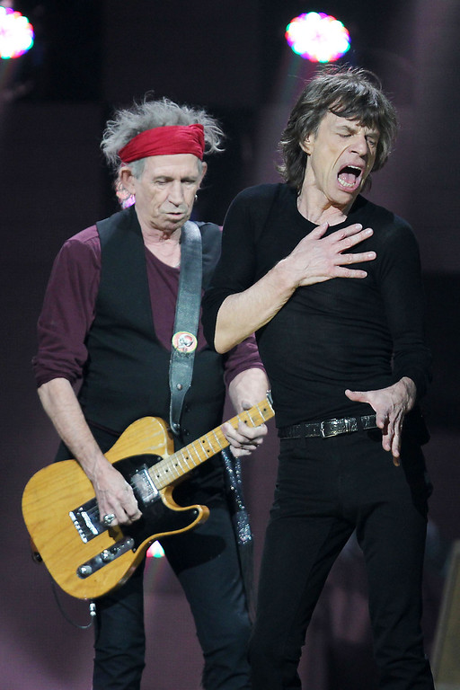 Description of . This image released by Starpix shows Keith Richards, left, and Mick Jagger of The Rolling Stones performing at the 12-12-12 The Concert for Sandy Relief at Madison Square Garden in New York on Wednesday, Dec. 12, 2012. Proceeds from the show will be distributed through the Robin Hood Foundation. (AP Photo/Starpix, Dave Allocca)
