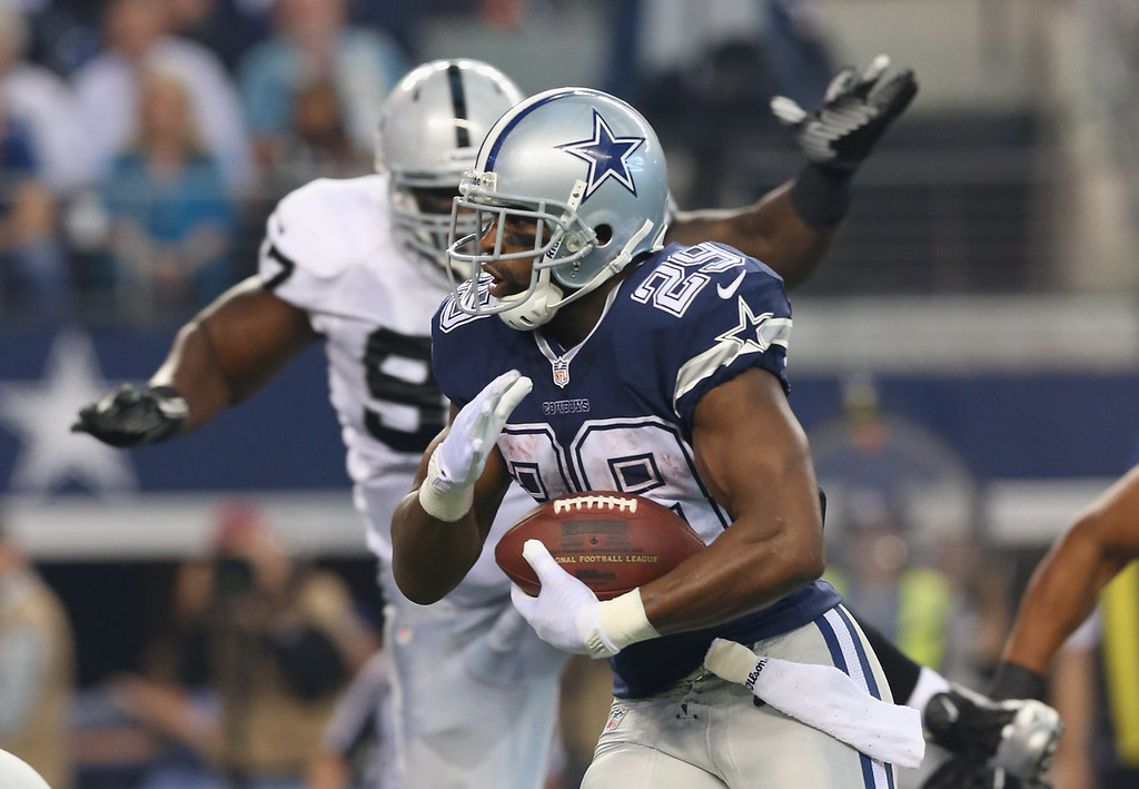 Description of . DeMarco Murray #29 of the Dallas Cowboys runs for a touchdown against the Oakland Raiders at AT&T Stadium on November 28, 2013 in Arlington, Texas.  (Photo by Ronald Martinez/Getty Images)