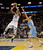 Memphis Grizzlies forward Rudy Gay (22) shoots against Denver Nuggets forward Danilo Gallinari (8), of Italy, in the second half of an NBA basketball game on Saturday, Dec. 29, 2012, in Memphis, Tenn. The Grizzlies won 81-72. (AP Photo/Lance Murphey)