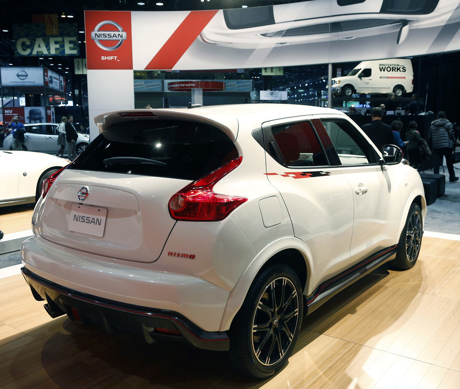 Description of . The 2013 Nissan Juke Nismo is revealed at the Chicago Auto Show Thursday, Feb. 7, 2013, in Chicago. (AP Photo/Charles Rex Arbogast)