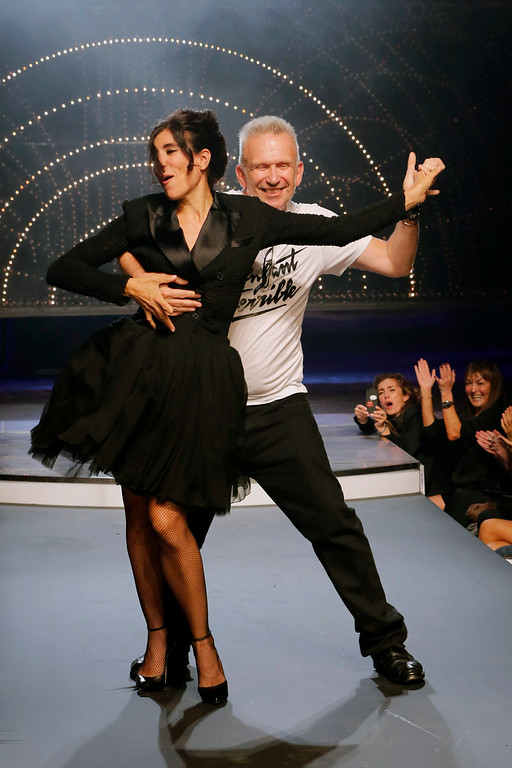 Description of . Fashion designer Jean-Paul Gaultier, right, and choreographer Blanca Li perform a dance, following the presentation of Gaultier's ready-to-wear Spring/Summer 2014 fashion collection, Saturday, Sept. 28, 2013 in Paris. (AP Photo/Jacques Brinon)