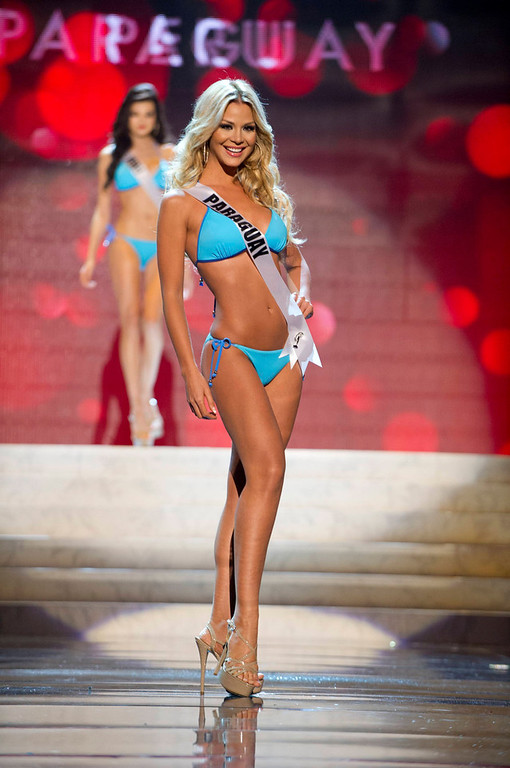Description of . Miss Paraguay Egni Eckert competes in her Kooey Australia swimwear and Chinese Laundry shoes during the Swimsuit Competition of the 2012 Miss Universe Presentation Show at PH Live in Las Vegas, Nevada December 13, 2012. The 89 Miss Universe Contestants will compete for the Diamond Nexus Crown on December 19, 2012. REUTERS/Darren Decker/Miss Universe Organization/Handout