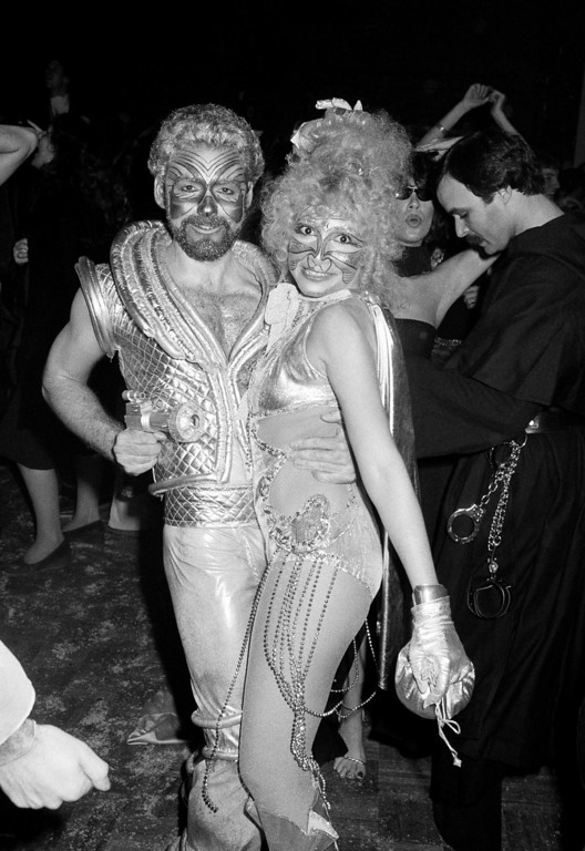 Description of . Halloween revelers at New York's Studio 54 dance the night away in costumes ranging from burlesque to stellar. The party was held at the New York Discoteque Oct. 31, 1977. (AP Photo/Richard Drew)