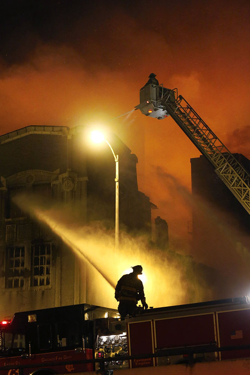 Description of . Chicago firefighters battle a five-alarm blaze in single digit temperatures at a warehouse on the city's South Side, Bridgeport neighborhood Wednesday, Jan. 23, 2013, in Chicago. (AP Photo/Charles Rex Arbogast)