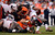 Tampa Bay Buccaneers running back Doug Martin #22 gets stopped by Denver Broncos outside linebacker Wesley Woodyard #52 during the third quarter.  The Denver Broncos vs The Tampa Bay Buccaneers at Sports Authority Field Sunday December 2, 2012. John Leyba, The Denver Post