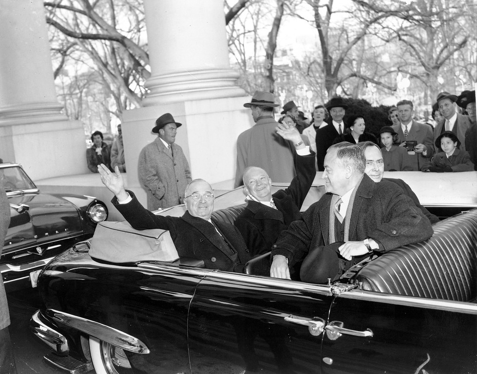 Description of . With smiles and a wave, U.S. President Harry Truman, left, and his successor, president-elect Dwight D. Eisenhower, leave the White House in an open car for inauguration ceremonies in Washington, D.C. on Jan. 20, 1953. Sitting in the front is Sen. Styles Bridges of New Hampshire, and behind him is House Speaker Joe Martin. (AP Photo)