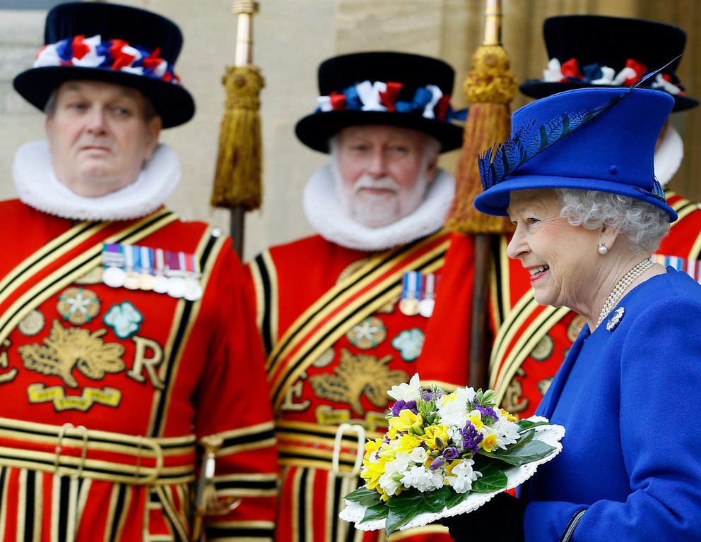 Description of . Britain's Queen Elizabeth walks past Yeomen of the Guard as she leaves the Maundy Service at Christ Church Cathedral in Oxford, southern England March 28, 2013. REUTERS/Kirsty Wigglesworth/Pool