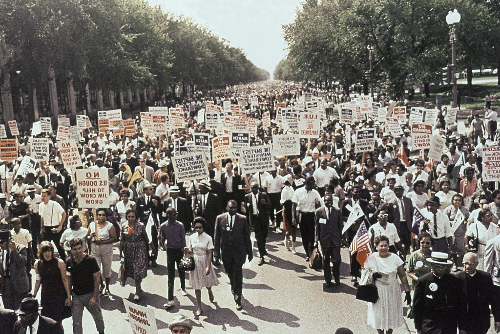 Description of . Large crowds gather at the Washington Monument to demonstrate for the civil rights movement in Washington, D.C., on August 28, 1963. (AP Photo)