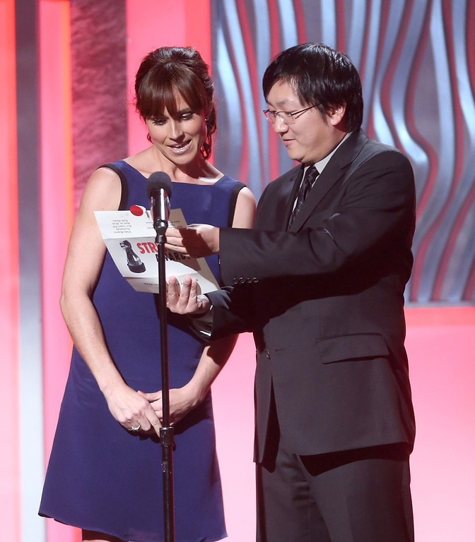 Description of . Presenters Nikki DeLoach and Masi Oka speak onstage at the 3rd Annual Streamy Awards at Hollywood Palladium on February 17, 2013 in Hollywood, California.  (Photo by Frederick M. Brown/Getty Images)