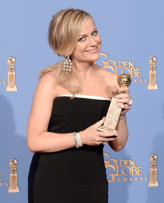 Description of . Actress Amy Poehler, winner of Best Actress in a Television Series - Musical or Comedy for \'Parks and Recreation,\' poses in the press room during the 71st Annual Golden Globe Awards held at The Beverly Hilton Hotel on January 12, 2014 in Beverly Hills, California.  (Photo by Kevin Winter/Getty Images)