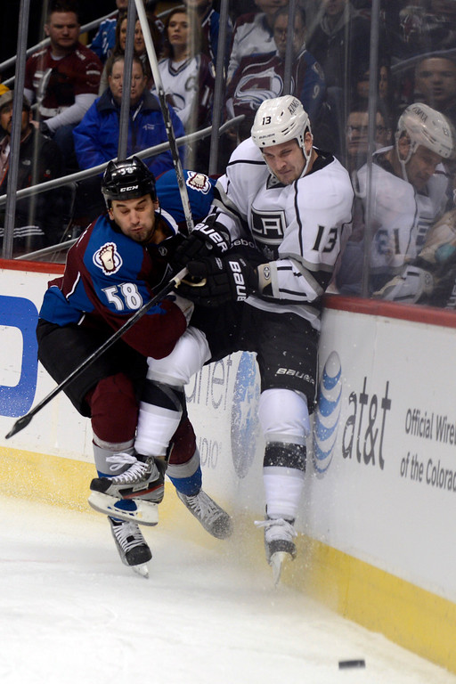 Description of . DENVER, CO. - JANUARY 22: Colorado Avalanche left wing Patrick Bordeleau (58) checks Los Angeles Kings left wing Kyle Clifford (13) during the first period. The Colorado Avalanche hosted the Los Angeles Kings at the Pepsi Center on January, 22, 2013.    (Photo By John Leyba / The Denver Post)