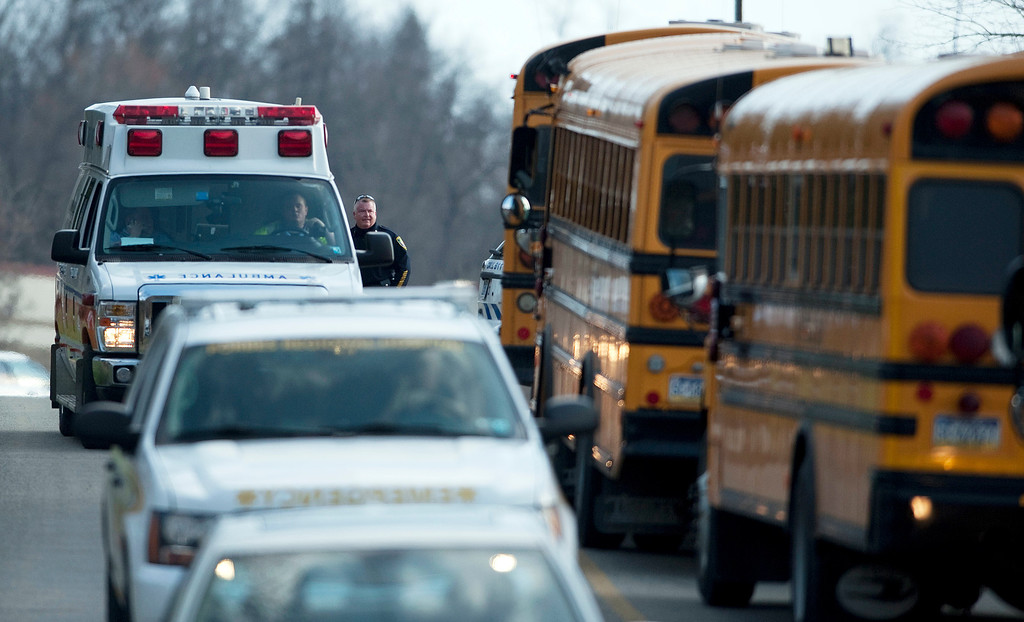 Description of . An ambulance and emergency vehicles leave Franklin Regional High School where more then a dozen students were stabbed by a knife wielding suspect on Wednesday, April 9, 2014, in Murrysville, Pa., near Pittsburgh. The suspect, a male student, was taken into custody and is being questioned. (AP Photo/Tribune Review, Brian F. Henry)
